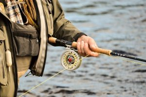 A man holding a fly rod