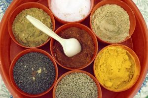 An assortment of spices in bowls.