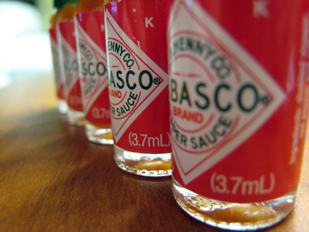 A row of small Tabasco sauces.