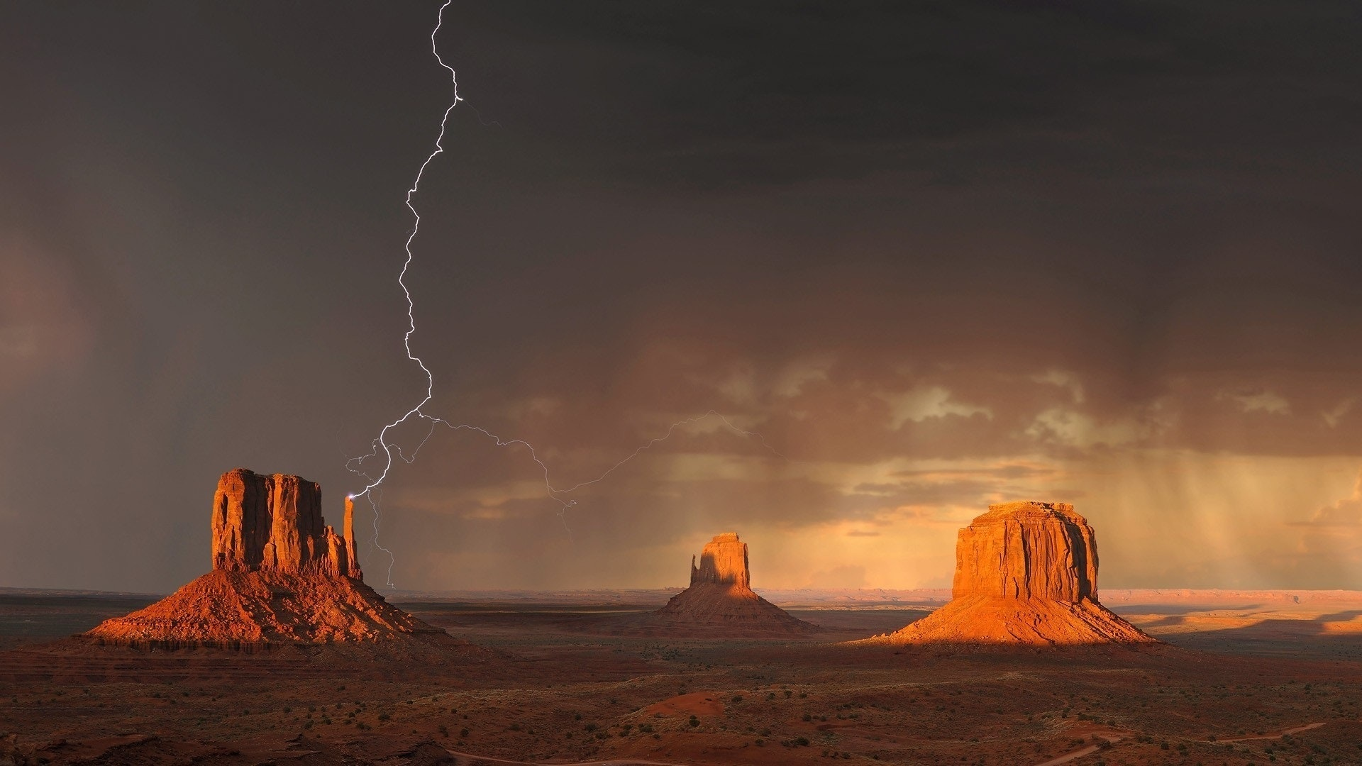 A lightning bolt strikes a rock formation in the desert