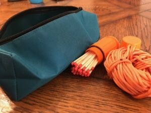 A survival kit with paracord and matches