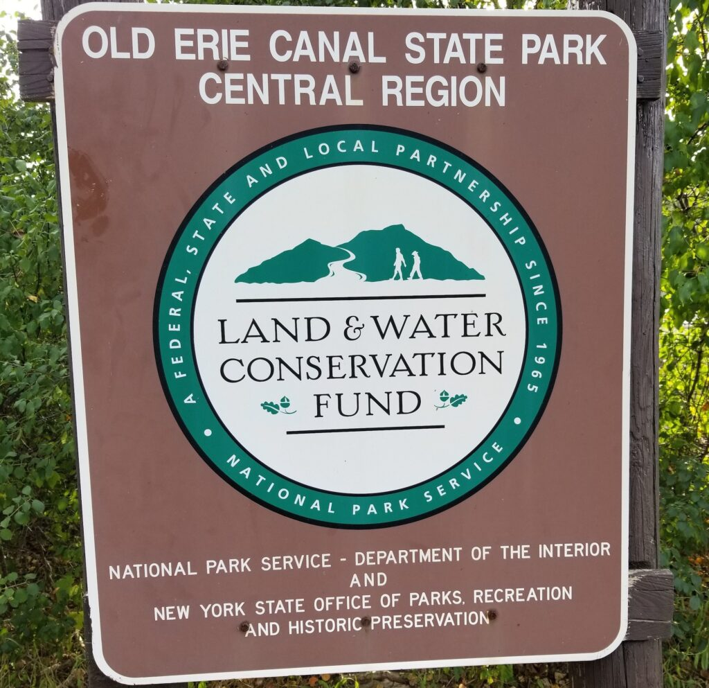 A sign at the Old Erie Canal State Park showing that it was funded by the Land and Water Conservation Fund