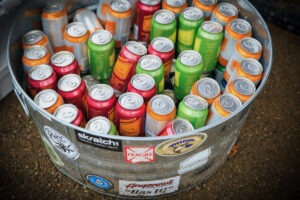 A barrel of multicolored beer cans