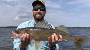 Mark Norquist holds a nice walleye for the camera